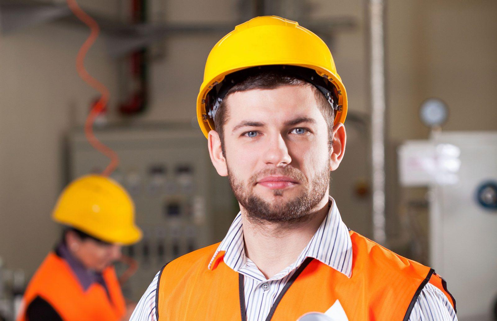 Man in hard hat in industrial factory